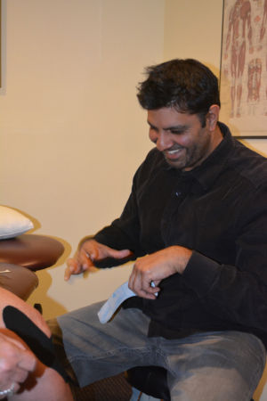 Sanjay describing treatment to a patient